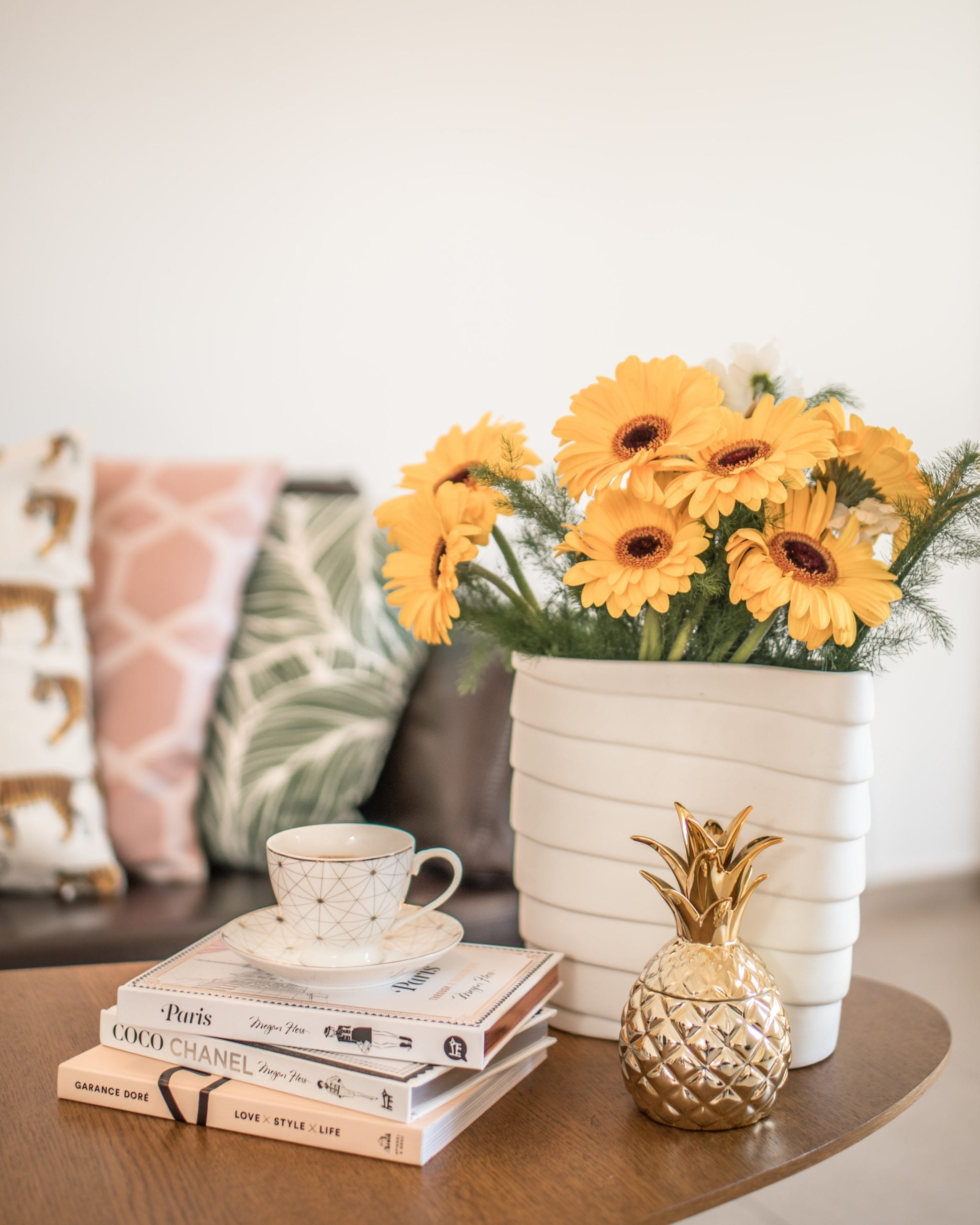 coffee table with sunflowers books tea pillows and a decorative pineapple-alive-counselling-kelowna-british-columbia-online-counselling-barb-egan