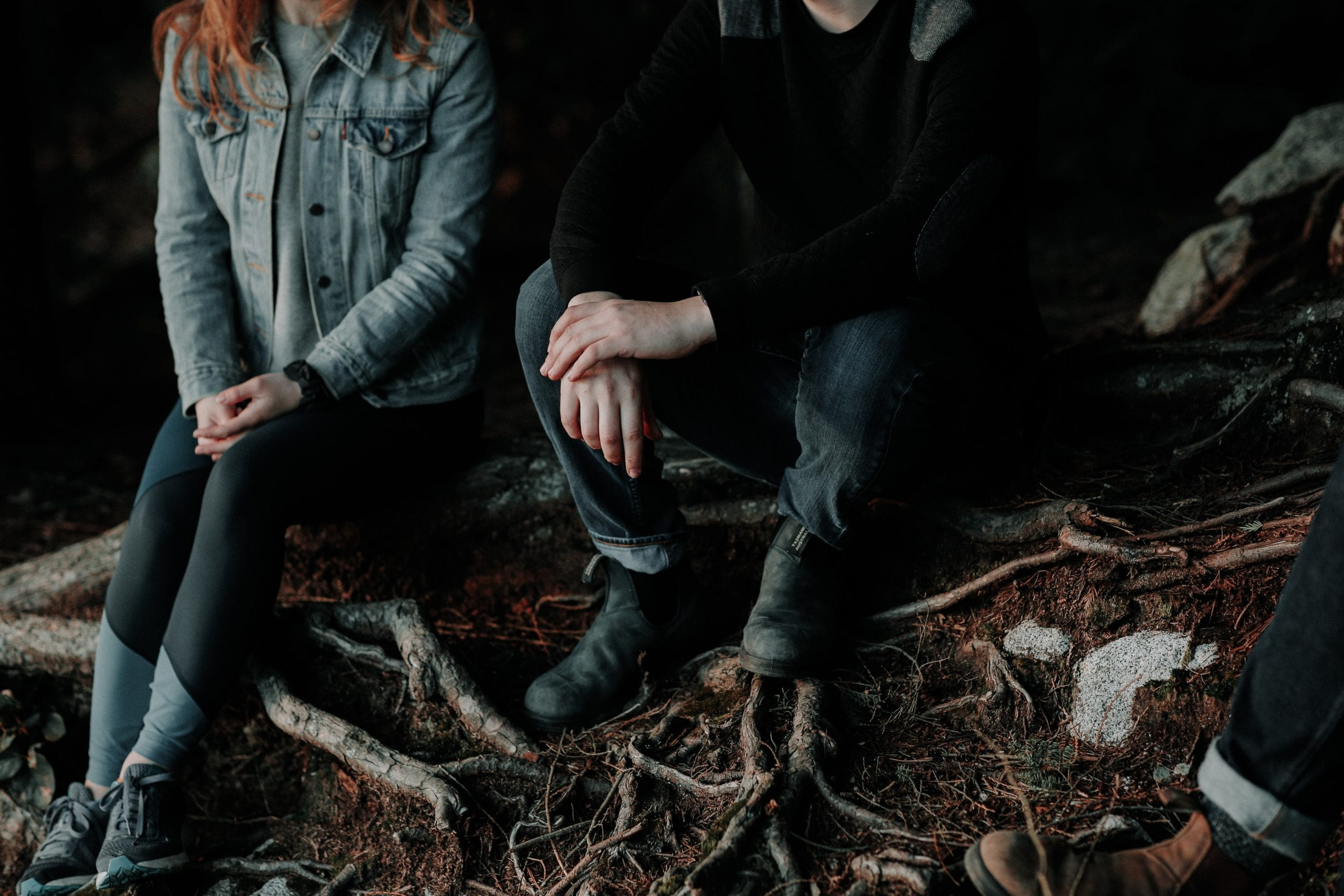 couple-talking-in-dark-woods-at-a-cafe-marriage-relationship-couples-counselling-therapy-communication-kelowna-british-columbia-alive-counselling