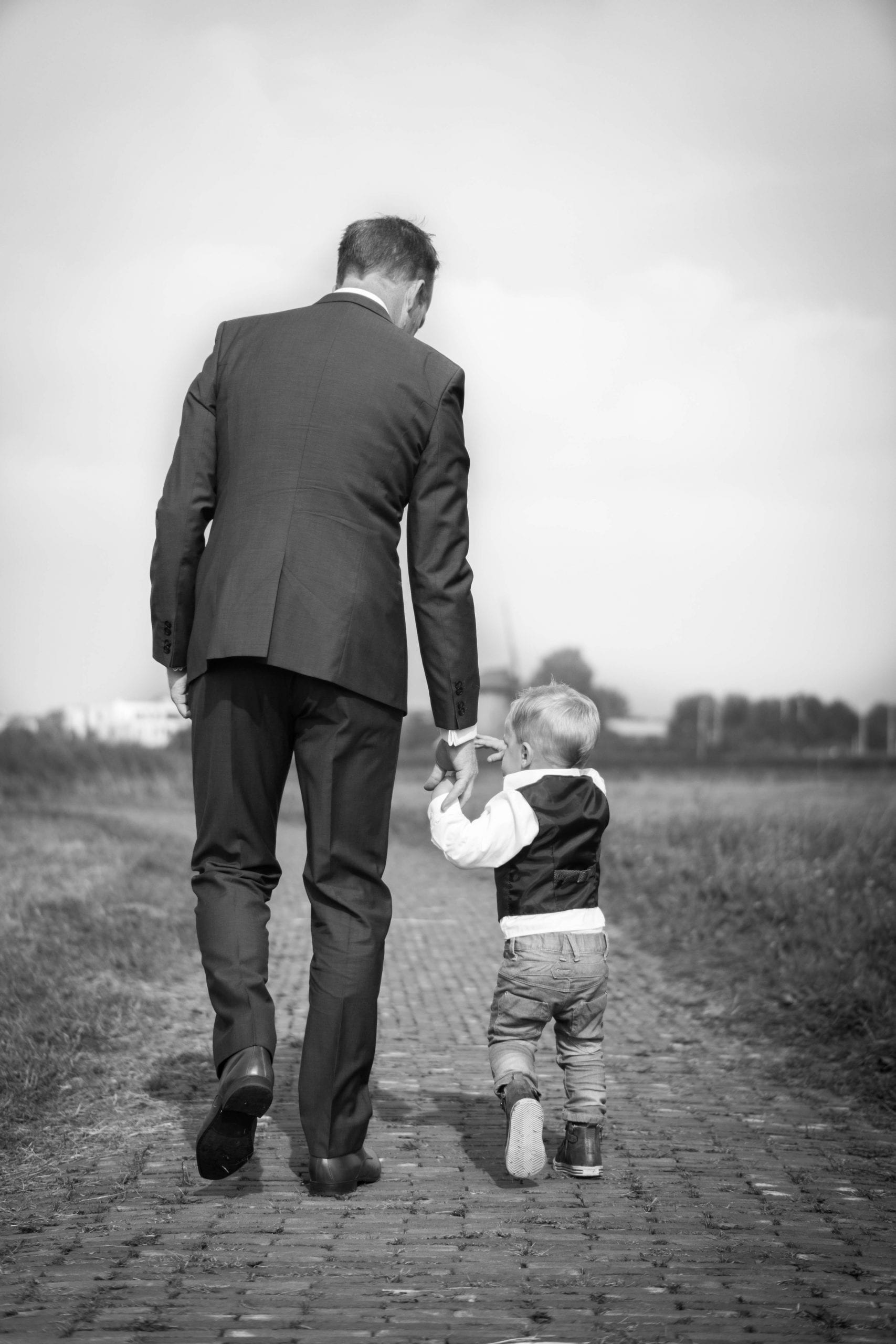 Custom Link father-walking-with-small-son-black-and-white